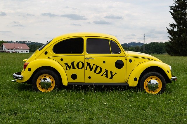 yellow bettle car with Monday written on it