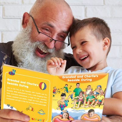 grandad and grandson reading a book featuring themselves and their family