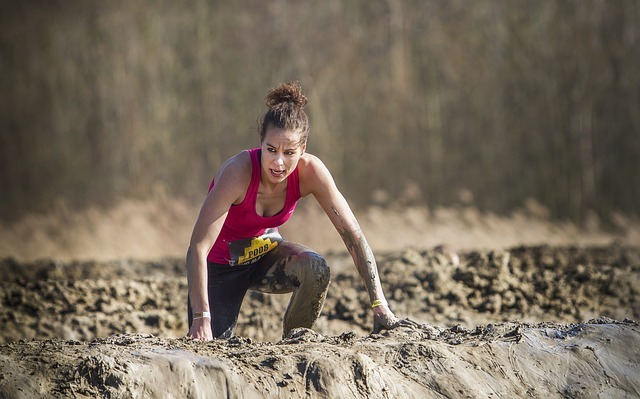 Woman wading through the mud during the race