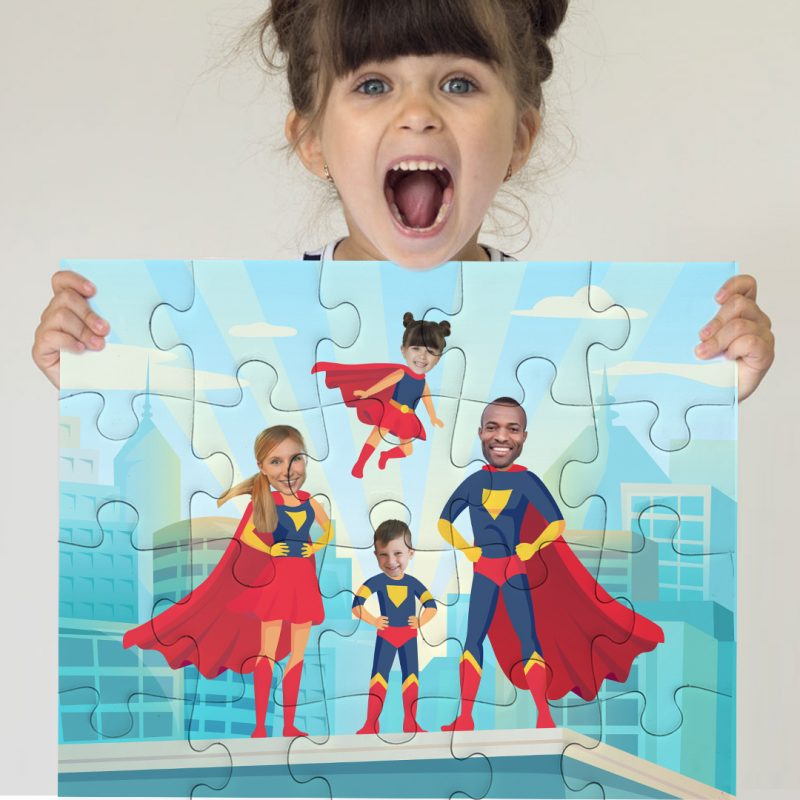 Girl holding Jigsaw Puzzle of her family as Superheroes