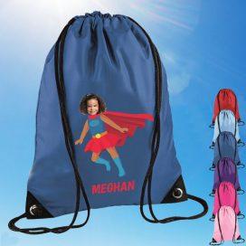 blue drawstring bag with supergirl image