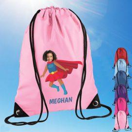light pink drawstring bag with supergirl image