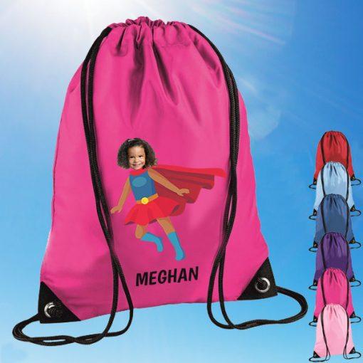 pink drawstring bag with supergirl image