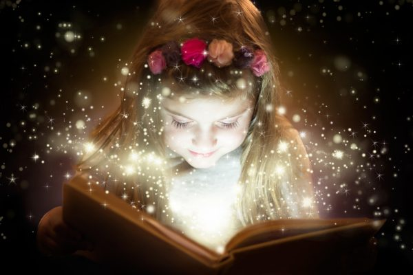 girl reading magical book