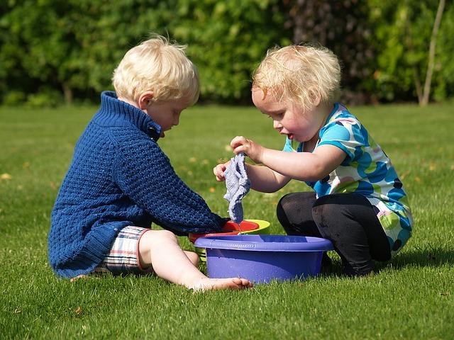 children washing clothes