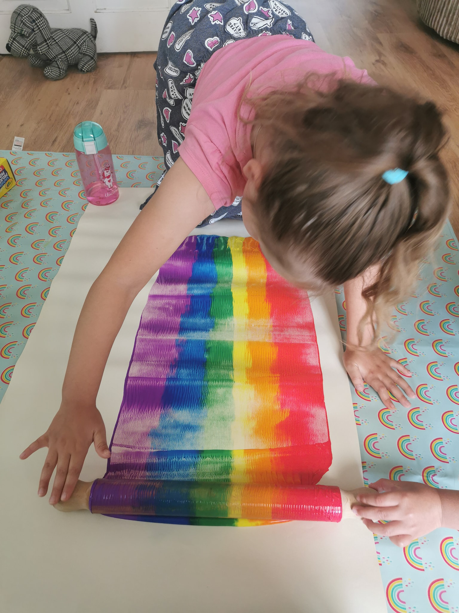 make a rainbow with a rolling pin and paint
