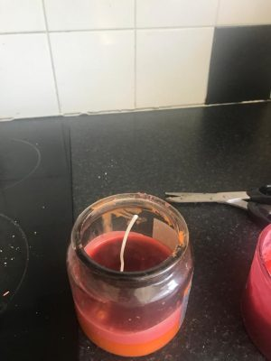 wick in red and orange wax